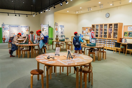OSAKA JAPAN  OCTOBER 27: Museum of History in Osaka Japan on October 27 2014. Unidentified Japanese students make a field trip to the Naniwa Archaeological Resource Centre