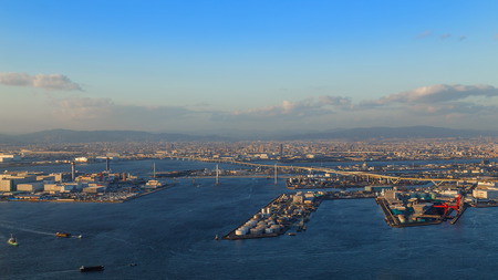 OSAKA JAPAN  OCTOBER 28: Osaka Bay in Osaka Japan on October 28 2014. Industries locate around Osaka Bay because there are skilled and plentiful workforce many port facilities efficient linkages