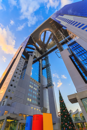 bldg: OSAKA, JAPAN - OCTOBER 27: Umeda Sky Bldg. in Osaka, Japan on October 27, 2014. A pair of skyscrapers connected in midair built in an unusual architectural form, one of the citys most recognizable landmarks
