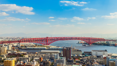 span: OSAKA, JAPAN - OCTOBER 28: Minato Bridge in Osaka, Japan on October 28, 2014. Opened in 1974, a double-deck cantilever truss bridge. It is the third-longest cantilever truss span in the world Editorial