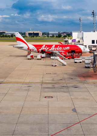 operates: BANGKOK, THAILAND - OCTOBER 19: AirAsia in Bangkok, Thailand on October 19, 2014. Malaysian low-cost airline that operates domestic and international flights to 100 destinations spanning 22 countries Editorial