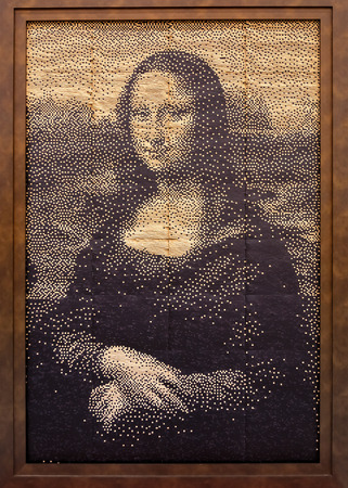 mona lisa: OSAKA, JAPAN - OCTOBER 29: Replica Paintings in Osaka, Japan on October 29, 2014. Reproduction of famous painting Mona Lisa is created by Japanese train ticket and displayed at Kansai airport station