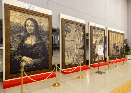 reproduction: OSAKA, JAPAN - OCTOBER 29: Replica Paintings in Osaka, Japan on October 29, 2014. Reproduction of famous paintings are created by Japanese train ticket and displayed at Kansai airport station