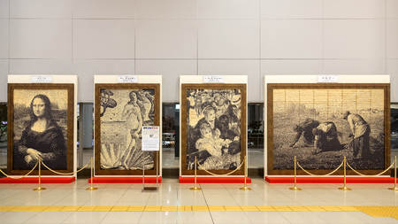 famous paintings: OSAKA, JAPAN - OCTOBER 29: Replica Paintings in Osaka, Japan on October 29, 2014. Reproduction of famous paintings are created by Japanese train ticket and displayed at Kansai airport station