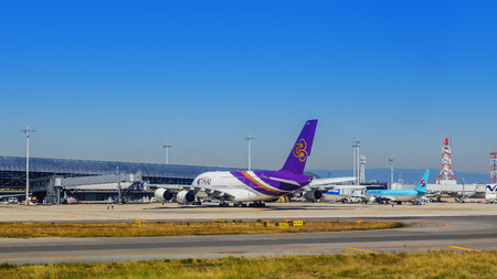 founding: OSAKA, JAPAN - OCTOBER 30: Thai Airways in Osaka, Japan on October 30, 2014. A founding member of the Star Alliance, flies to 78 destinations in 35 countries, using a fleet of more than 80 aircraft
