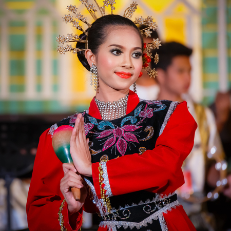 manora: BANGKOK, THAILAND - JANUARY 16: Thai Culture Festival in Bangkok, Thailand on January 16, 2015. Participants take part in the celebration of Thai Traditional Culture Festival at Lumpini Park Editorial