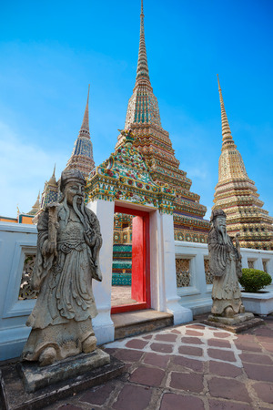 wat pho: Guardian Statues at Wat Pho Pho Temple in Bangkok, Thailand Stock Photo