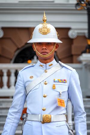 royal guard: BANGKOK, THAILAND - DECEMBER 24: The Grand Palace in Bangkok, Thailand on December 24, 2014. Unidentified royal guard is on duty at the Grand Palace of Thailand