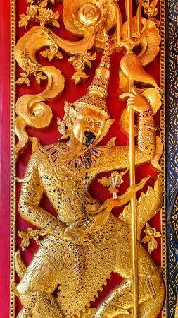 wat bowon: Low Reliefe on the door of Wat Bovorn Bowon Nivet Viharn in Bangkok, Thailand