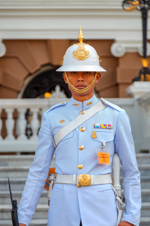 the emerald city: BANGKOK, THAILAND - DECEMBER 24: The Grand Palace in Bangkok, Thailand on December 24, 2014. Unidentified royal guard is on duty at the Grand Palace of Thailand