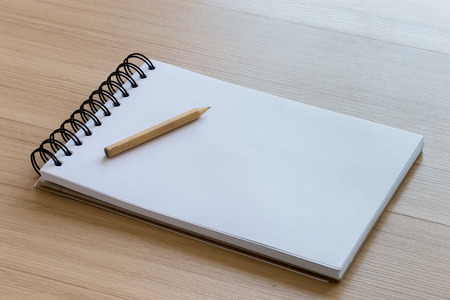 notebook: Wood Pencil Placed on a Blank Notebook