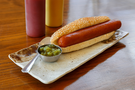 breakfast food: Hotdog with a Big Sausage in a Plate on a Table