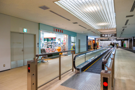 on duty: TOKYO, JAPAN - NOVEMBER 29, 2015: Duty free area with duty free shops at the terminal two of Narita international airport
