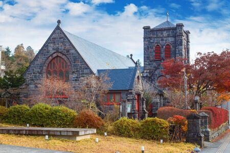 koyo: The Nikko Shinko Church Chapel in Nikko, Tochigi, Japan  NIKKO, JAPAN - NOVEMBER 17, 2015: Built frome stones by the American James McDonald Gardiner, Nikko Shinko Church Chapel located 800m west of Toshogu shrine