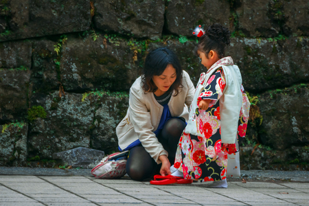 Nikko, Japan - November 17 2015: Parents and Children at Toshogu shrine in a Traditional rite of passage and festival day in Japan for 3 and 7-year-old girls and 3 and 5-year-old boys Editorial