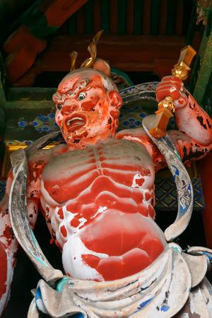 benevolent: The two benevolent Kings stand guards at Omotemon Gate or Niomon Gate in front of Nikko Toshogu Shrine in Nikko, Tochigi, Japan  NIKKO, JAPAN - NOVEMBER 17, 2015: The two benevolent Kings stand guards at Omotemon Gate or Niomon Gate in front of Nikko Tosh