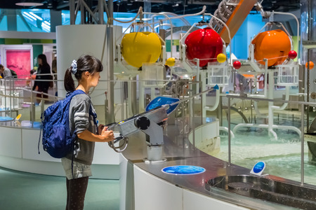 NAGOYA, JAPAN - NOVEMBER 18, 2015: Nagoya City Science Museum houses the largest planetarium in the world, it portrays life sciences and general science with a variety of hands-on exhibits Editöryel