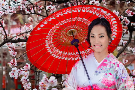 koyo: Young Japanese Woman in A Japanese Garden in Autumn