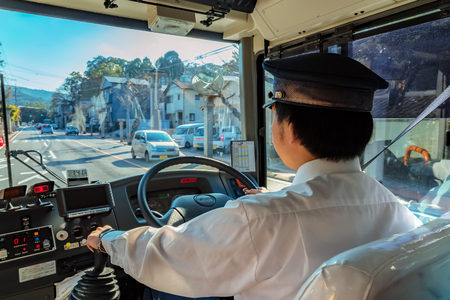 MIE, JAPAN - NOVEMBER 20, 2015: A Japanese bus driver's on the way to Ise-jingu shrine in Ise city