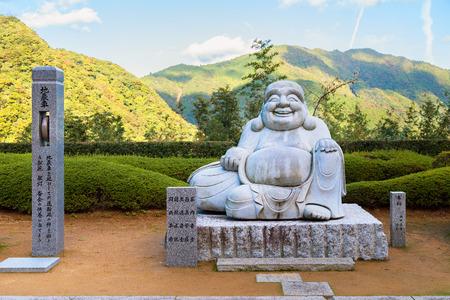 gautama buddha: Smile Kensenen Buddha, in Seiganto-ji temple, Wakayama, Japan  WAKAYAMA, JAPAN - NOVEMBER 19, 2015: Smile Kensenen Buddha, believed to be the symbol of wealth, located in Seiganto-ji temple