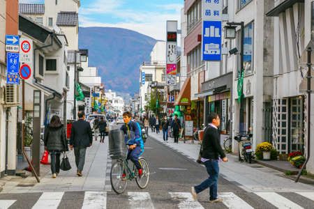 nice food: MATSUMOTO, JAPAN - NOVEMBER 21, 2015:  Nakamachi Street is a beautiful street with nice little shops, cafes with some nice food and cocktails, many historical buildings still found here