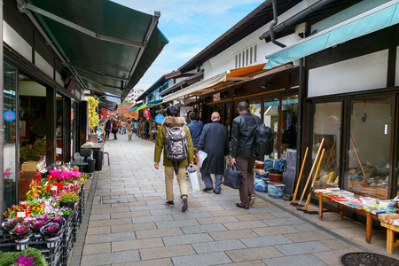 dori: MATSUMOTO, JAPAN - NOVEMBER 21, 2015: Nawate Dori, a shopping street that gives the feel of  citys history as a castle town with around 50 shops vary from antique dealers and dagashi candy stores Editorial