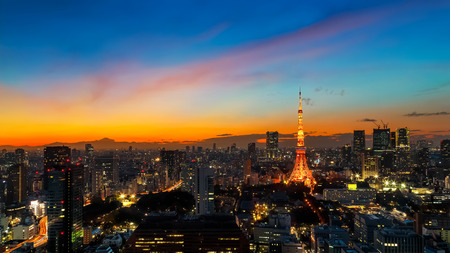 Tokyo Tower in Twilight  TOKYO, JAPAN - NOVEMBER 28, 2015: Tokyo Tower built in 1958, it was the main source of antenna leasing and tourism, over 150 million people visited the tower since its opening.
