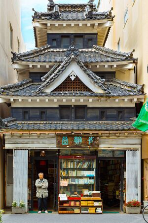 replicated: MATSUMOTO, JAPAN - NOVEMBER 21, 2015: Unidentified book shop with replicated style of the famous Crow Castle or Matsumoto castle situated nearby the original site