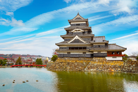 Matsumoto Castle in Matsumoto City, Nagano, Japan   MATSUMOTO, JAPAN - NOVEMBER 21, 2015: Matsumoto Castle, one of Japans premier historic castles, along with Himeji Castle and Kumamoto Castle, its known as Crow Castle due to its black exterior