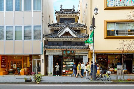 MATSUMOTO, JAPAN - NOVEMBER 21, 2015: Unidentified book shop with replicated style of the famous Crow Castle or Matsumoto castle situated nearby the original site
