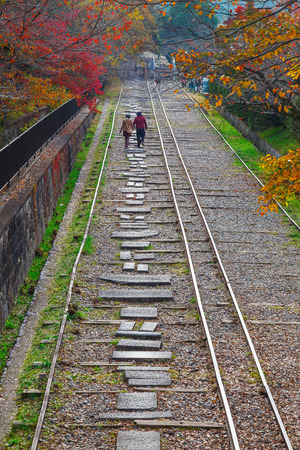 to incline: Keage incline, near Nanzenji Temple in Kyoto, Japan                                                                                                  KYOTO, JAPAN - NOVEMBER 22 2015: Behind Nanzenjis aqueduct along a small canal to the Keage Incline. This Editorial