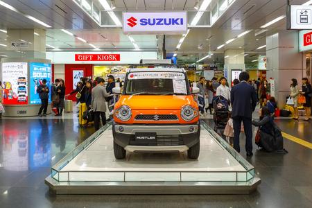 hustler: OSAKA, JAPAN - NOVEMBER 22 2015: Suzuki Hustler - a compact SUV, RJC (The Automotive Researchers' and Journalists' Conference of Japan) Car of the Year 2013 displayed at Shin Osaka station