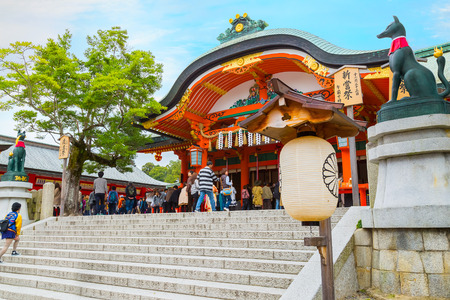 messengers of god: KYOTO, JAPAN - NOVEMBER 23 2015: Fushimi Inari-taisha  is the most important of several thousands of shrines dedicated to Inari, the Shinto god of rice. Editorial