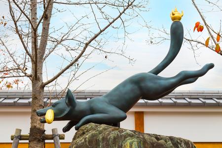 messengers: Kitsune Fox sculpture at Fushimi Inari-taisha shrine in Kyoto    KYOTO, JAPAN - NOVEMBER 23 2015: Kitsune Fox sculpture at Fushimi Inari-taisha shrine, regarded as the messengers, are often found in Inari shrines Editorial