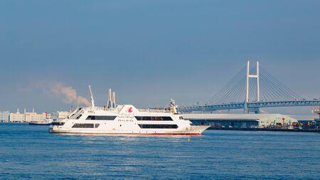 YOKOHAMA, JAPAN - NOVEMBER 24 2015: Yokohama Port has 10 major piers. In 2013, the Port served 37,706 ships. It handled 271,276,977 tons of cargo and 2,888,220 TEU containers