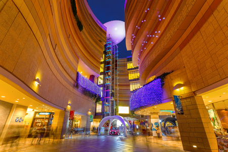gradually: OSAKA, JAPAN - NOVEMBER 23 2015: Namba Parks is an office and shopping complex features a lifestyle commercial center with a rooftop park that crosses multiple blocks while gradually ascending eight levels