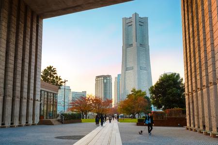 whose: Minatomirai Area With Skyscrapers in the Evening                                                            YOKOHAMA, JAPAN - NOVEMBER 24 2015: Minato Mirai 21 is a seaside urban area in central Yokohama whose name means Harbor of the Future Editorial