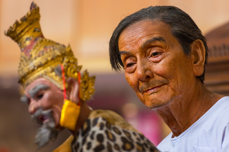 puppet master: Bangkok, Thailand - January 16 2016: Waxwork of Mr. Sakorn Yankeosod (A.K.A. Joe Louis), the master of thai traditional puppet displayed in the occasion of celebrating H.R.H. Princess Sirindhorns birthday
