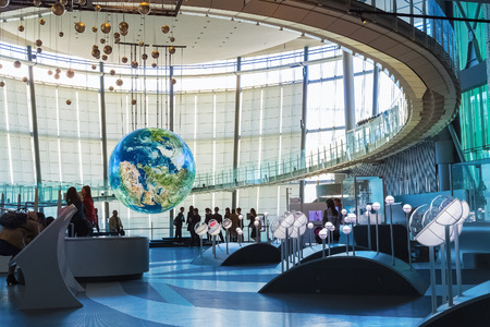 """TOKYO, JAPAN - NOVEMBER 27 2015: The National Museum of Emerging Science and Innovation , known as the Miraikan literally """"Future Museum"""" created by Japan's Science and Technology Agency"""
