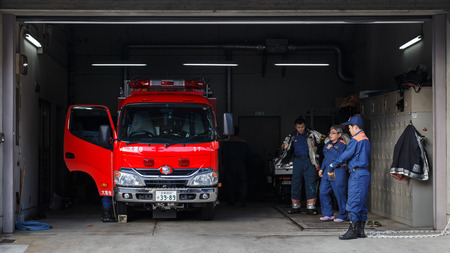 fire brigade: KYOTO, JAPAN - NOVEMBER 23 2015: Unidentified Japanese fire brigade in a fire station