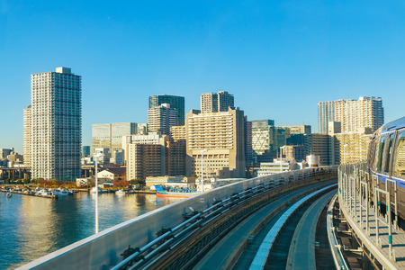 Motion blur of train moving inside tunnel in Odaiba, Tokyo, Japan                                                          TOKYO, JAPAN - NOVEMBER 27 2015: Cityscape from Yurikamome monorail sky train in Odaiba, the artificial island in Tokyo