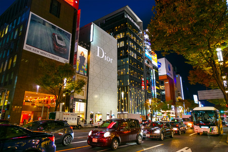 upmarket: TOKYO, JAPAN - NOVEMBER 28 2015: The Ginza is the Tokyos most famous upmarket shopping, dining and entertainment district featuring numerous department stores, boutique, art galleries, restaurants and cafe