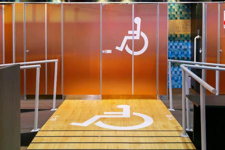 Handicap Sign in front of a Public Toilet