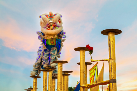 BANGKOK, THAILAND - FEBRUARY 20: A group of people perform a lion dance during Chinese new year's celebration Editorial