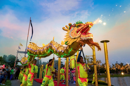 BANGKOK, THAILAND - FEBRUARY 20: A group of people perform a dragon dance during Chinese new year's celebration