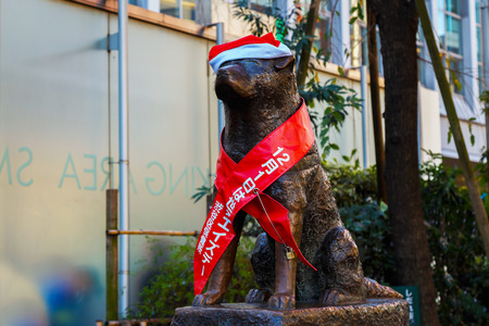 k9: TOKYO, JAPAN - NOVEMBER 28 2015: Hachiko statue at Shibuya station, the dog is remarkable loyalty to his owner which continued for ten years waiting for his owner at thw station after his owners death Editorial