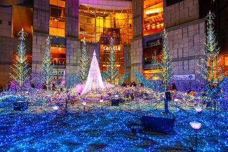 colourful lightings: TOKYO, JAPAN - NOVEMBER 27 2015: Illuminations light up at at Caretta shopping mall in Shiodome district, Odaiba area. The illuminations prepared for the forth coming Christmas Eve