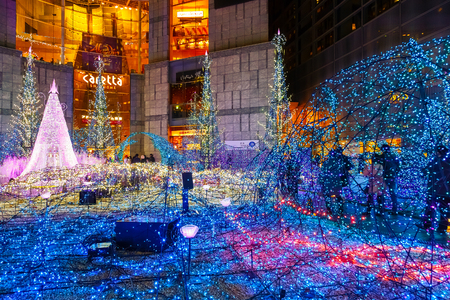 TOKYO, JAPAN - NOVEMBER 27 2015: Illuminations light up at at Caretta shopping mall in Shiodome district, Odaiba area. The illuminations prepared for the forth coming Christmas Eve