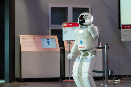 tec: TOKYO, JAPAN - NOVEMBER 27 2015: Asimo, the humanoid robot created by Honda is presented at Miraikan, The National Museum of Emerging Science and Innovation in Odaiba area Editorial