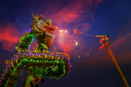 BANGKOK, THAILAND - FEBRUARY 20: A group of people perform a dragon dance during Chinese new years celebration